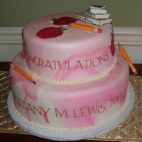 Graduation Cake  2 tier cake for a young lady who received her M.Ed, and wanted the cake decorated with an educator's theme...complete with pencils,...