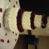 Dcfc0229.jpg Wedding cake I did a few weekends back. White Almond Sour Cream with Strawberry filling for bottom; Butter cake with chocolate and Bav....