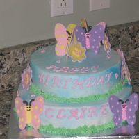 Butterflies Gumpaste butterflies and flowers with royal icing details. Made this for our realtor's daughters 3rd birthday.