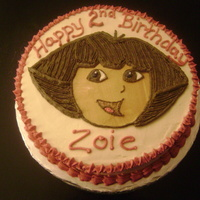 Dora The Explorer Dora's face hand-sketched on buttercream for a 2nd birthday.