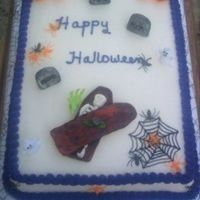 Not So Scary Halloween Cake This is a cake a customer ordered. She wanted white icing with purple border and fondant accents. The pumpkins,ghosts, and little green...