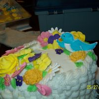 100_0880.jpg Final cake for Wilton course 2. Wish it had come out better..