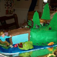 Fisherman This was a vanilla and chocolate cake for my sons 11th bday. Everything is edible except the fisherman and little plastic animals. The big...