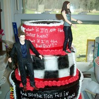 My Daughters 7Th Birthday This is a 3 teired Twilight cake all edible except the dolls. The images are edible. Chocolate and vanilla with BC. Took al long time to do...