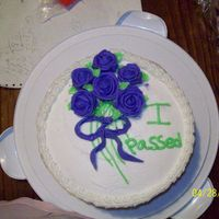 100_0862.jpg Wilton course 1 final cake....I'm a terrible rose maker but it didnt come out that bad....