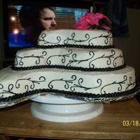 100_0773.jpg This is a practice wedding cake my first try. Its all buttercream