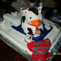 100_0575.jpg This is a cow duck cake i made for my neices first birthday...all buttercream, faucet made out of rice krispies treats and covered in...