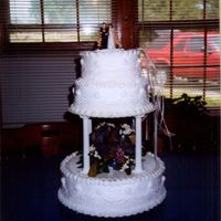 First Wedding Cake This was my first wedding cake that I decorated. Even though the customer was a little nutty, it turned out in the end. It also was a...