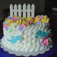 Wilton Course Ii Class Cake Oval layer cake, basket-weave, rope borders, royal flowers, and color flow birds and fence.