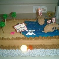 Pirates On The Beach This was a very quick Pirate cake because I dont have any boat or some thing I made the boats with royal icing and all the details with...