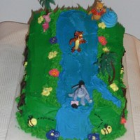 Pooh And Friend Cake   Pooh an d friends on water slide. Cake yellow cake with buttercream icing, flowers with royal icing, Pooh characters.