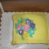 Yellow Pillow Cake   pillow cake, made with fondant icing , and buttercream frosting flowers