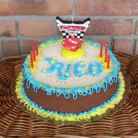 Birthday Cake For Rico 2007 Had this CARS candle and tried to make a festive cake for my nephew who turned 6.