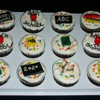 Back To School Cupcakes MMF decorations on buttercream icing.