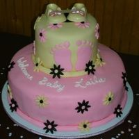 Baby Shower Cake Lemon cake covered with MMF and candy shoes.