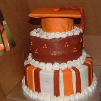 Orange And Brown Graduation Cake