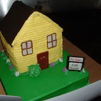 For A Lady Who Just Got Her Realtors License Carved house with buttercream and fondant accents.