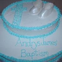 Andrys' Baptism Baby boy baptism cake. Booties made from gumpaste and sprayed with pearl luster by bakery crafts.