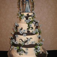 Corpse Bride Wedding Cake 4 tiers, top was foam, white cake with buttercream. trellis made out of wire with tootsie rolls on it it. then wrapped with ivy vines and...