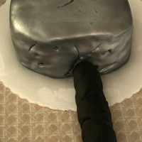 Thor's Hammer White cake covered with fondant, handle was rice krispies. Was second cake for a four cake stacked cake to be entered in a cake show in...