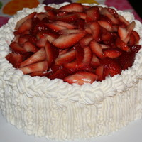 Strawberry Whipped Cream Cake Vanilla whipped cream sponge cake with whipped cream and cream cheese frosting, topped and filled with fresh strawberries.