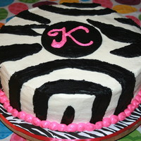 Zebra K Vanilla cake topped with buttercream.
