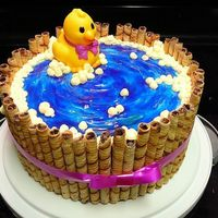 Rubber Duck In A Tub Baby shower cake for a friend. I love how this turned out. the watter was made by frosting white buttercream in a spiral then covering it...