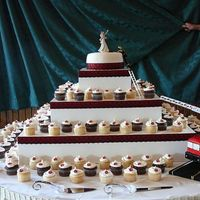 Wedding Cup Cake Tower red black and white wedding with 150 cupcakes small top cake and a fire truck for grooms cake. white and chocolate cake filled with...
