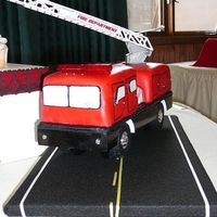 Fire Truck fire truck grooms cake. the lights and sirens work. the groom loved it.