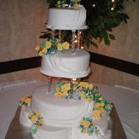 Yellow Roses This is a cake I did this weekend for a friends wedding. It is buttercream then covered in Satin Ice. The flowers are all gumpaste made by...