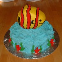 Fish Cake   Two layer white base cake w/ a chocolate carved ball cake for the fish. All decorated in BC frosting.