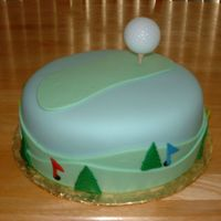 Fondant Golf This was done as a birthday cake. The ball was a plastic practice ball super glued to a real tee. BC underneath MFF decorations.