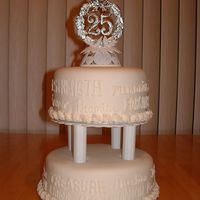 25Th Anniversary   Vanilla and chocolate cakes covered with vanilla bc then covered in MMF. Writing done in bc.