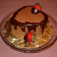 Choclate Chocolate   Two layer chocolate cake with chocolate BC frosting and ganache dipped strawberries.