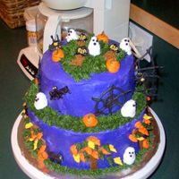 My 1St Halloween Cake the spider webs, spiders and cats are made out of royal icing and the rest is buttercream