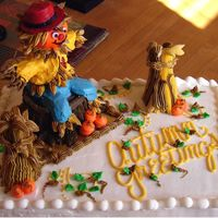 Fall Greetings Made for a cake auction at my nephews school for Halloween. It is all edible. The scarecrow is made using a ice cream cone as a base.