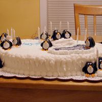 Penguin Birthday Cake  Birthday cake for my niece. She is very into penguins at the moment. There was one penguin on the cake for her and each girl she invited to...