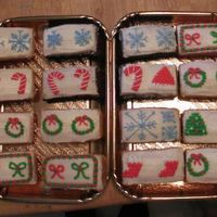 Christmas Mini Cakes Mini Cakes...all cream cheese frosting. 4 different kinds of cakes - chocolate, white, orange and lemon. Made 78 mini cakes as gifts. Baked...