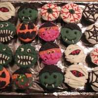 Monster Halloween Cupcakes My first paid order (courtesy of my wonderful sister). Cream cheese frosting with chocolate mousse filling. I had a lot of fun with these...