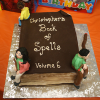 "Wizards Of Waverly Place Spellbook Cake A birthday cake for my 6 year old son. He requested ""Alex, Justin, and Max sitting on the cake"", so I did the best I could! Thank..."