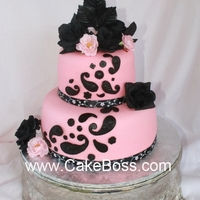 "Pink And Black Paisley 6"" and 9"" round, MMF with silk flowers. French vanilla cake with alternating layers of bavarian cream and CakeBoss raspberry..."