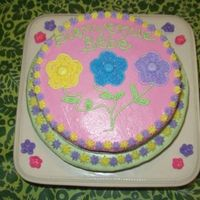Sd__P1010135.jpg All buttercream with royal icing flowers on the cake stand.