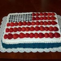 4Th Of July This cake was made with buttercream, strawberry mousse filling, strawberries and blueberries.