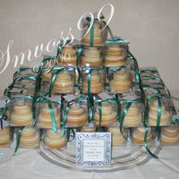 Stacked Cookie Wedding Cake Favors  Done as a bridal brunch favor for a best friend. 8 iced sugar cookies make up one mini wedding cake, boxed in a PVC 3x3x3 box with ribbon...