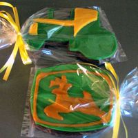 John Deere Cookies   Rolled chocolate sugar cookie with MMF as a base with royal icing deere accents.