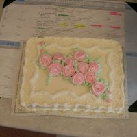 Pretty In Pink Ivory cake with pink flowers, made for a doll club meeting.