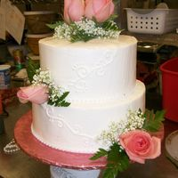 Fresh Flowers And Scrolls Small wedding cake with fresh flowers, pearls, and scroll work (although it's hard to see).