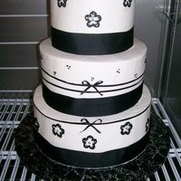 Black Bows A wedding cake with black ribbon and brushed flowers