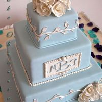 "Mayone 6,10, 14"" chocolate cakes. Fondant pearls, gumpaste plaque, fondant monogram,all other details in fondant dusted with super pearl dust..."