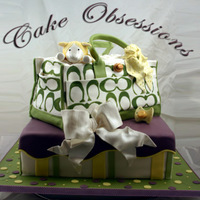 Coach Diaper Bag This is a copy of the Tara cake as requested by customer. Colors were adapted to suit surprise gender. The lamb is dusted with cornmeal and...